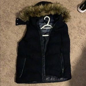 Puffy vest with a fur lined hood